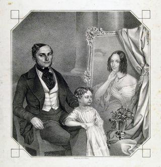 Vater mit Kind und dem Bild der Mutter
